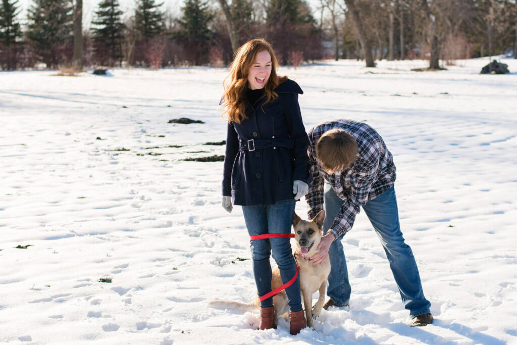 winter engagement picture with dog 1024x683 - Emily and Dez - Fargo Engagement