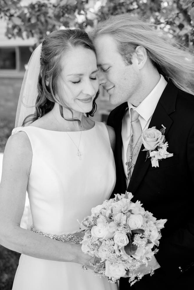 Ashley and Dusty 140 - Dusty and Ashley - Catholic North Dakota Wedding